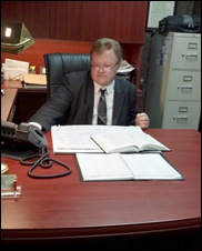 Tom Tabor in his office working